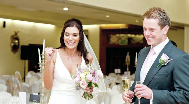 Newlyweds Jonathan and Clare Adair enjoy their wedding reception at the Dunadry Hotel