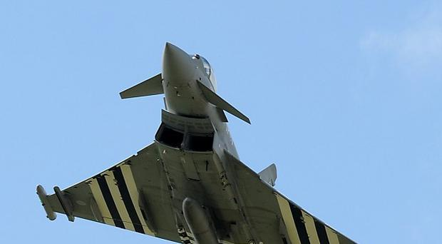 A Eurofighter Typhoon, featuring D-Day invasion stripes, at RAF Coningsby, Lincolnshire