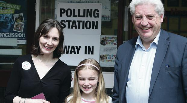 SDLP leader Alasdair McDonnell votes with his family
