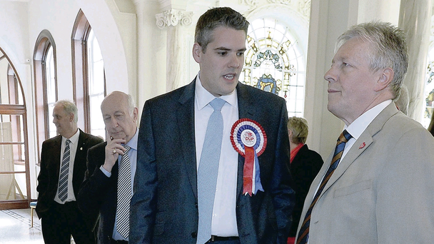 First Minister Peter Robinson at the May 2014 local council electoral count at Belfast City Hall with party member Gavin Robinson