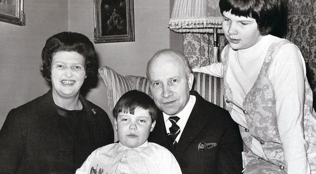 Sir Robert and Lady Porter at their south Belfast home with two of their children, Robert and Kathryn in 1971
