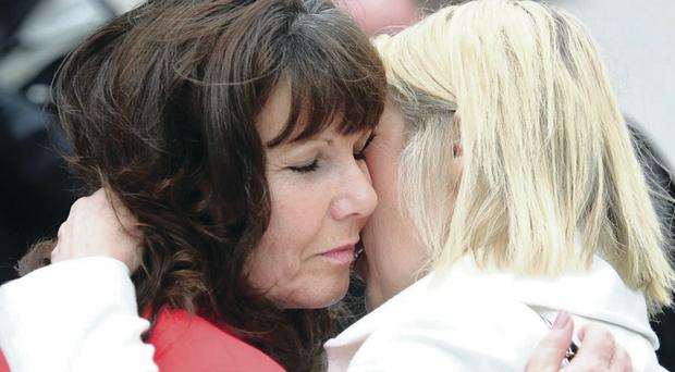 A relieved Kate Carroll gets a hug outside Belfast Court