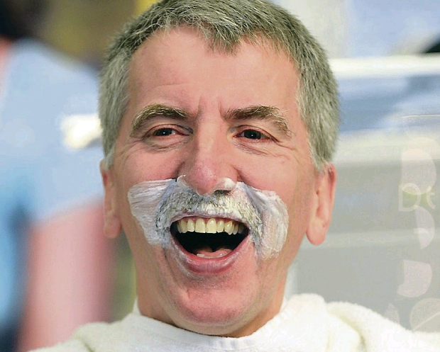 Mairtin O Muilleoir shaves off his moustache to help raise money for Phillipines appeal day