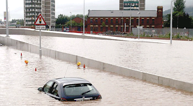 A car abandoned on the Westlink Road is seen at the junction with the M1 motorway in Belfast in 2008