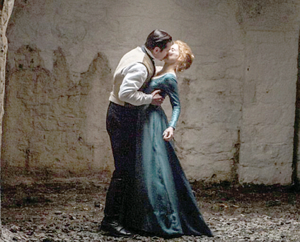 Colin Farrell and Jessica Chastain share a kiss in the grounds of Castle Coole