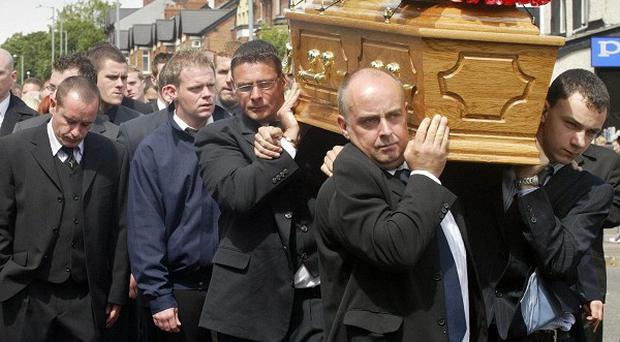 Family and friends carrying the coffin at the funeral of Craig McCausland