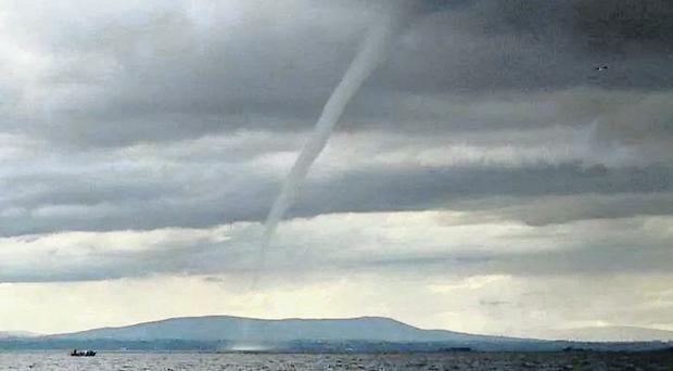 Fisherman Barry McGuigan's snap of the dramatic funnel cloud
