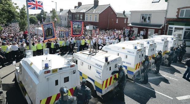 Loyalists protesters on the Woodvale Road after an Orange march was banned from walking past the Ardoyne shops last July 12