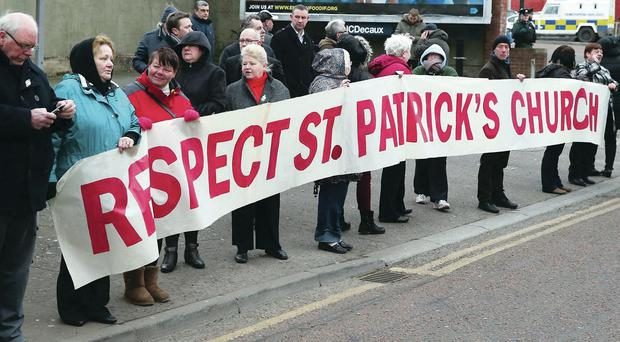 A nationalist residents' protest outside St Patrick's Catholic Church, Donegall Street, during a parade last year
