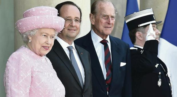 The Queen and Prince Philip are welcomed by French President Francois Hollande (centre) at the Elysee Palace, Paris, ahead of the 70th Anniversary of D-Day