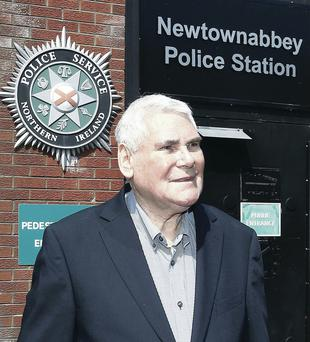Pastor James McConnell outside Newtownabbey PSNI station yesterday