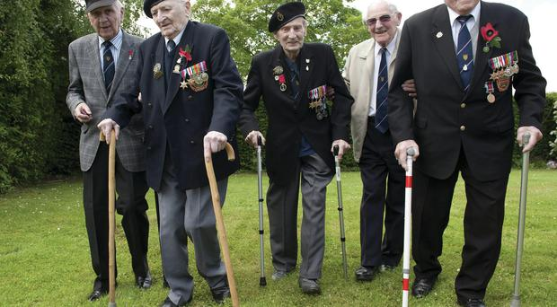 Members of the 16th Walsall branch of the Normandy Veterans' Association (from left) Sgt Ken Reynolds (90), Able Seaman Ronald Davies (88), Signalman Gordon Poole (89), Sub Lt Geoff Ensor (90) and Corporal Frank Corbett (93) arrive for the D-Day 70 Commemorations in France