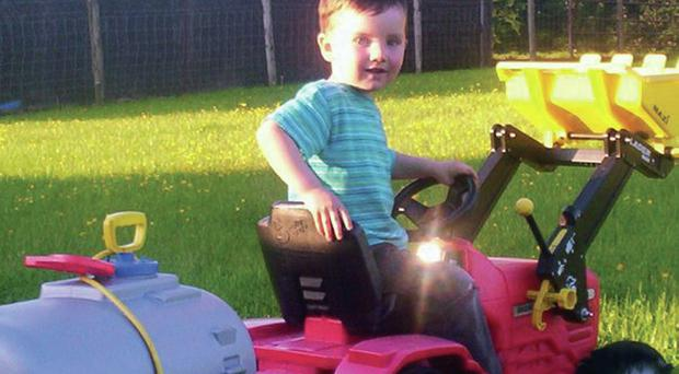 Robert Christie on his toy tractor at home in 2009