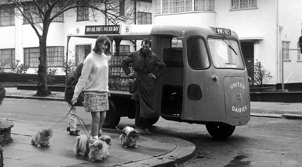A milkman makes his deliveries in the Sixties