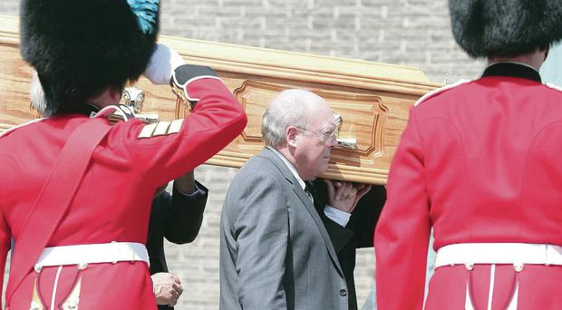 Sir John Gorman's coffin is given a guard of honour by the Irish Guards at St Mary's Star of the Sea Church, Killyleagh