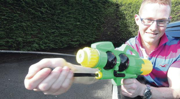 Philip Deazley with the plastic water pistol he fired at a PSNI Land Rover in Portstewart