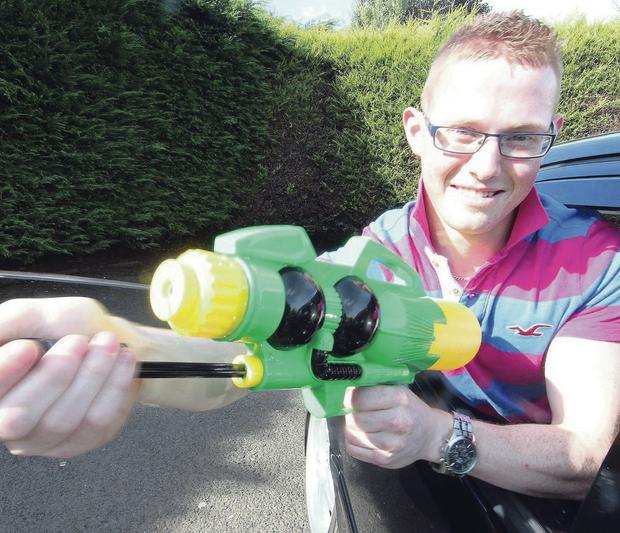 Philip Deazley with the water pistol he was squirting at passers-by at Portstewart Promenade