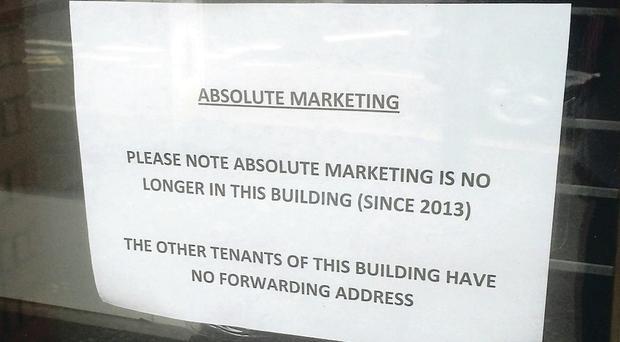 The sign in the widow of Absolute Marketing's office on Belfast's Ormeau Road yesterday