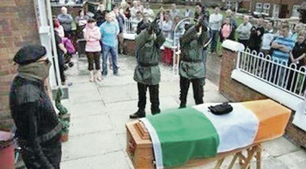 Shots are fired over flag-draped coffin at Ardoyne wake