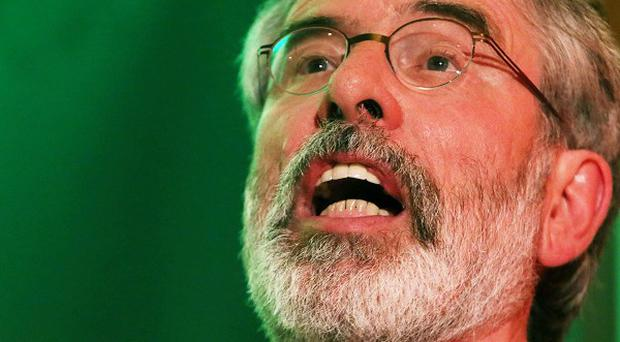 Gerry Adams has hit out at the DUP's stance on peace process issues.