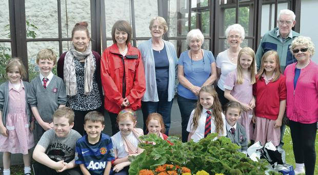 Residents with the schoolchildren who helped transform Wesley Court Sheltered Accommodation
