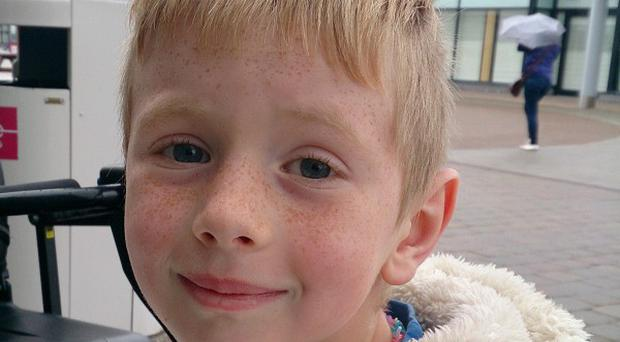 Seven-year-old Logan Crawford died after falling from cliffs in Northern Ireland