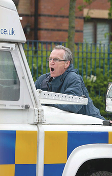 Gerry Kelly trying to block the police Land Rover last year