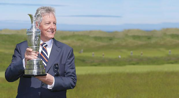 Peter Robinson holds The Open Championship's Claret Jug at Royal Portrush