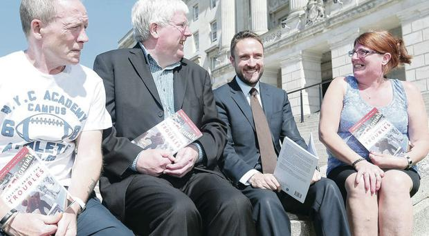 From left: Danny McGrath, Johnston Price, Chris Lyttle MLA and Violet Walker at the book launch at Stormont yesterday