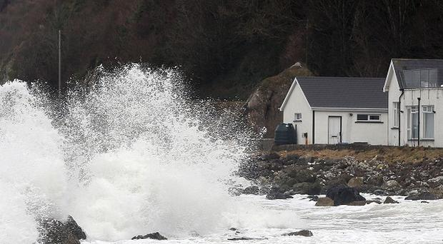 Waves crashing in on the Antrim coast earlier this year, as details of how officials prepared for the flooding were revealed