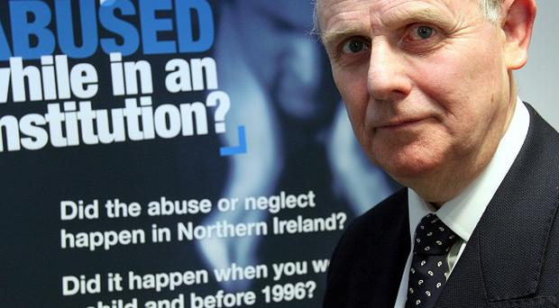 Sir Anthony Hart with a campaign poster in his Belfast office