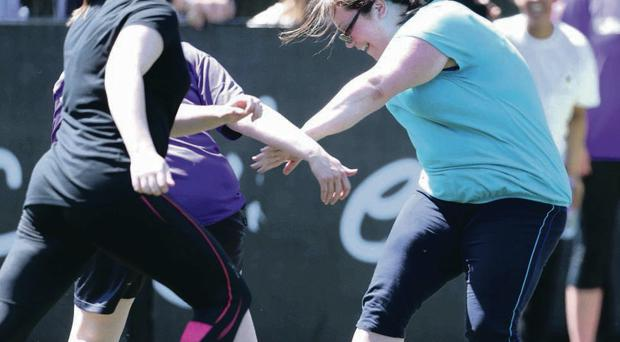 MLAs Megan Fearon and Judith Cochrane go for the ball