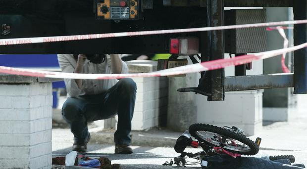 Police at the scene after a young girl was struck by a lorry on the Upper Newtownards Road in east Belfast yesterday