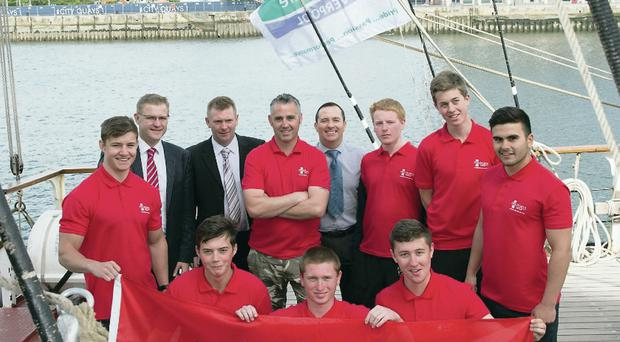 The Peel Ports Group apprentices show their colours after docking in Belfast yesterday