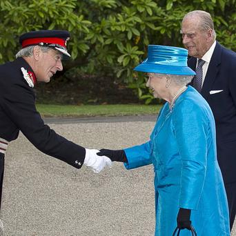 Lord Lieutenant of Co Down David Lindsay greets the Queen and the Duke of Edinburgh at Hillsborough Castle