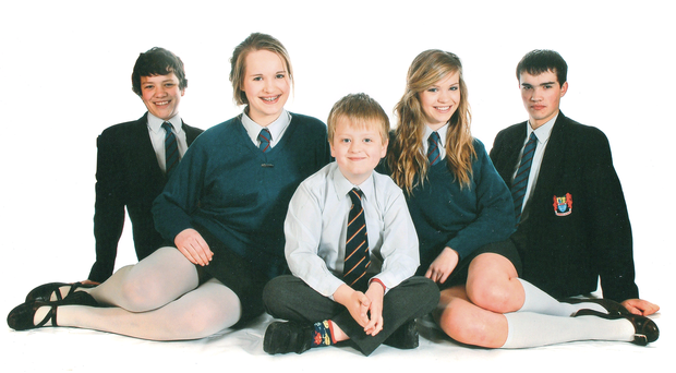 Aaron Macaulay (centre), who died in a farming accident, with his brothers and sisters