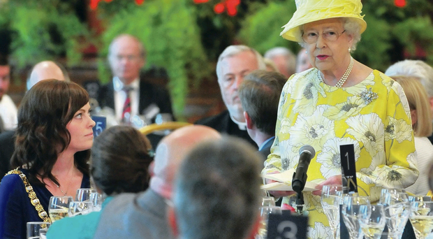 The Queen stands next to Lord Mayor Nichola Mallon as she gives a speech at a civic luncheon at Belfast City Hall