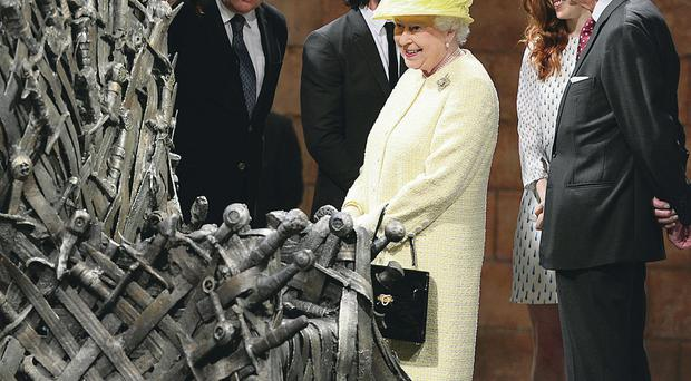 The Queen and the Duke of Edinburgh meet the cast and production crew from Game Of Thrones during a tour of the Painthall Studios in Belfast