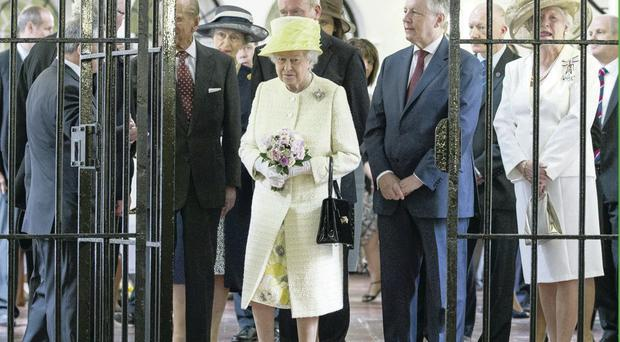 The Queen visits the Crumlin Road Gaol flanked by Peter Robinson and Martin McGuinness