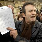 Gerry Conlon outside the House of Commons in 2005 showing the media the letter of apology he received from Prime Minister Tony Blair over his conviction