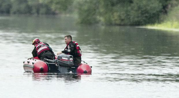 Emergency services at the scene after a car went off the road and into the Newry Canal