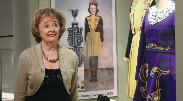 Irish dancing champion Pat Henderson admires some of the costumes at the exhbition, including her own