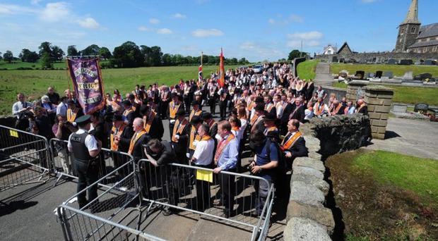 Orangemen protest after being refused permission to walk the Garvaghy Road last year