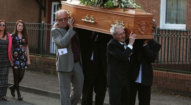 Birmingham Six member Paddy Hill (front left) carries the coffin of Gerry Conlon