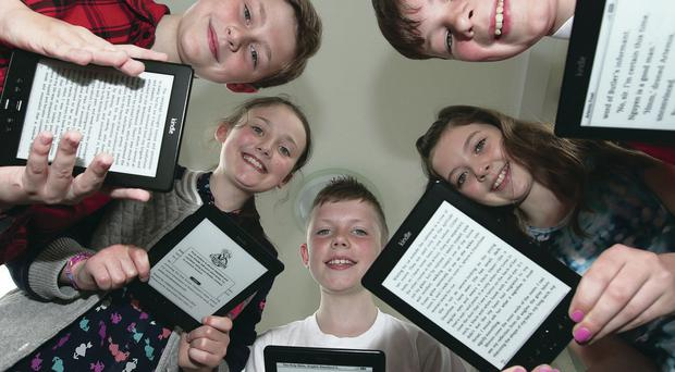 Ryan Irvine, Zoe Fleck, Reece Boyd, Oliva Humphreys and David Andrew are among the 187 soon-to-be first year pupils at Ballyclare High who have received Kindle e-readers as part of a school initiative to get children to read more. The e-books include texts to be studied in the classroom as well as popular contemporary fiction