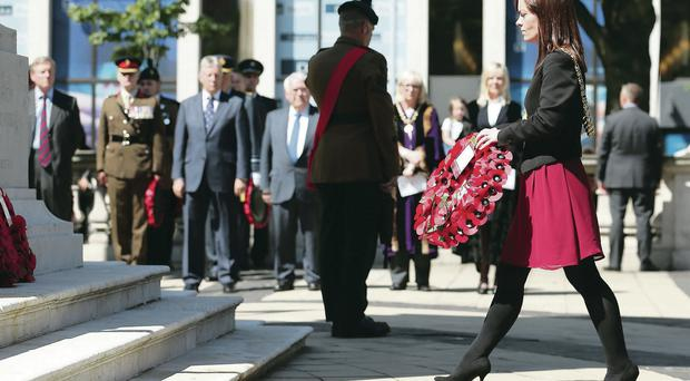 Belfast Lord Mayor Nichola Mallon lays a wreath yesterday at the cenotaph at City Hall to honour those who died in 1916