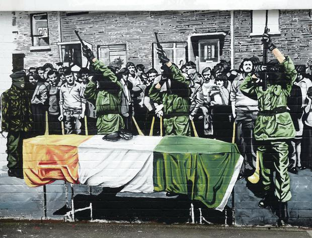 Part of the mural at Slemish Way in west Belfast depicting an IRA tribute at the funeral of hunger striker Kieran Doherty in 1981