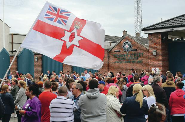 The scenes outside Tennent Street PSNI station in Belfast last night after members of the Pride of Ardoyne Flute Band presented themselves to police for questioning