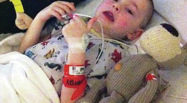 Cerebral palsy sufferer Oliver Dickey in typical pose after his vital operation