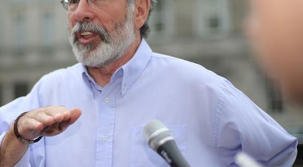 Sinn Fein leader Gerry Adams said the Irish and British governments should not acquiesce to unionist threats